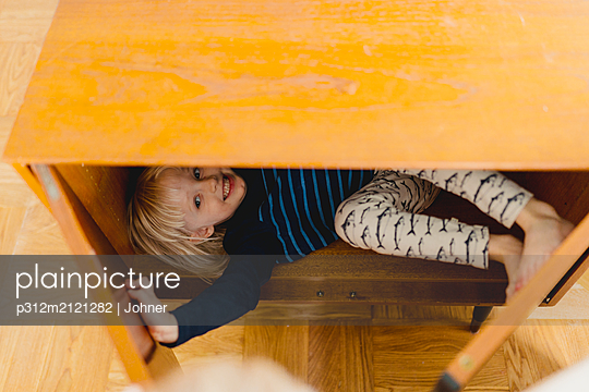 Girl hiding in cupboard - p312m2121282 by Johner