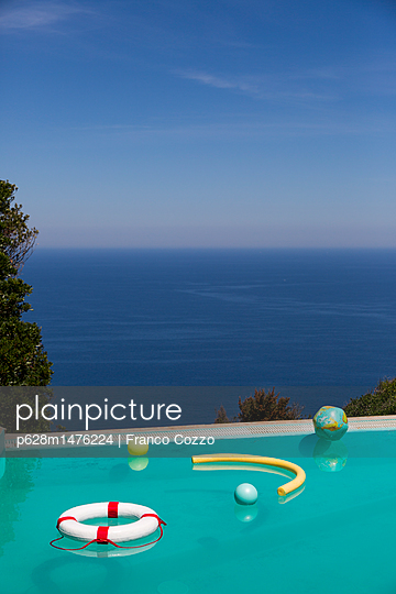 Water toys floating in pool - p628m1476224 by Franco Cozzo