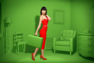 Caucasian woman in green old-fashioned bedroom carrying suitcase - p555m1304579 by Chris Clor