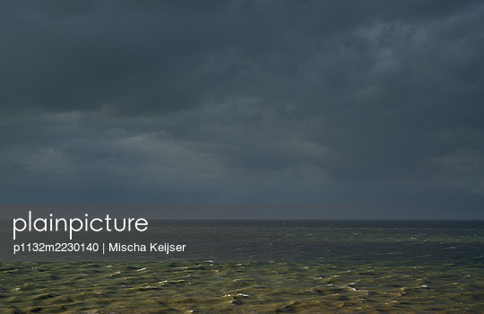 Dark clouds over the Sea - p1132m2230140 by Mischa Keijser