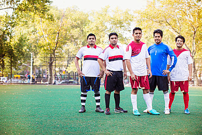 Portrait of athletes standing at soccer field - p1166m1098374f by Cavan Images