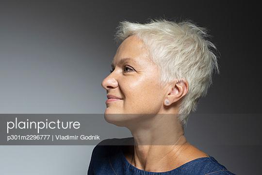 Profile portrait beautiful mature woman with short white hair - p301m2296777 by Vladimir Godnik