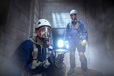 Apprentice engineers in enclosed space fire training - p429m1557555 by Monty Rakusen