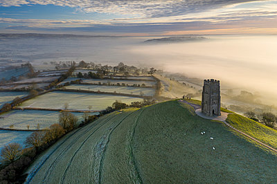 Aerial view by drone of frosty winter morning at Glastonbury Tor, Somerset, England, United Kingdom, Europe - p871m2209421 by Adam Burton