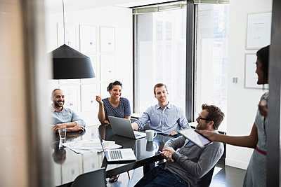 Business people talking in conference room meeting - p1192m1026898f by Hero Images