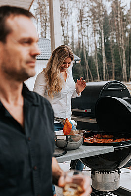 Woman having barbecue - p312m2191016 by Jennifer Nilsson