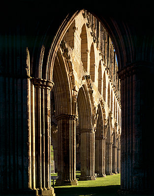 Rievaulx Abbey. View through silhouetted arch to Presbytery arcade looking NE. - p8551784 by Paul Highnam