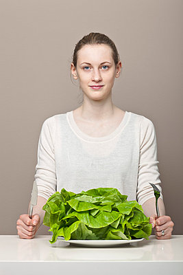 Young woman with salad - p1051178 by André Schuster