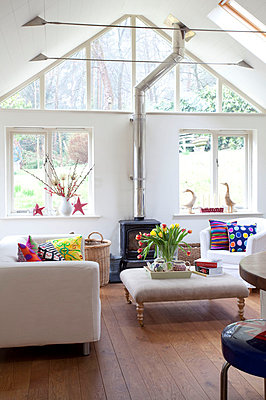 Living room with wood burner in Sussex home  UK - p3493569 by Robert Sanderson