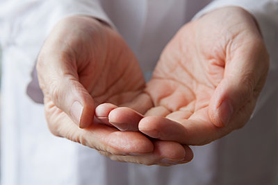 Cupped hands of Hispanic doctor - p555m1491160 by REB Images