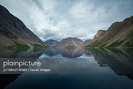 Cloudy skies over fjord and rugged mountains in Torngats Mountains National Park - p1166m2130965 by Cavan Images