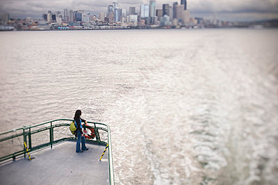 Woman on deck of ferry boat - p429m664741 by Mike Tittel