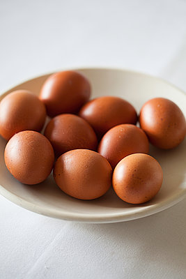bowl of brown eggs - p1470m1559132 by julie davenport