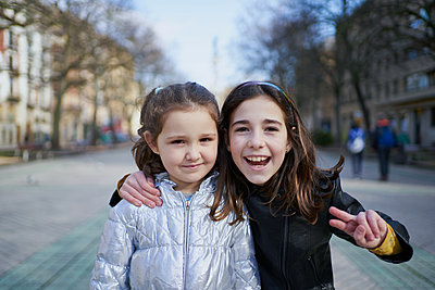 two happy girls look at the camera with a smile - p1166m2193873 by Cavan Images
