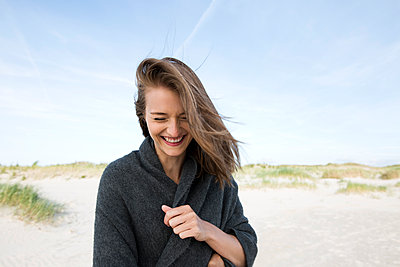 Young woman on beach with its dunes - p341m1480683 by Mikesch