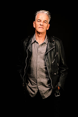 Portrait confident, cool senior man in leather jacket - p1192m2124095 by Hero Images
