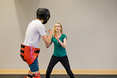 Woman training for self defense - p445m1503886 by Marie Docher