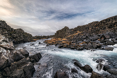 River flowing over rocks, Pingvellir, Southern Iceland, Iceland - p555m1491158 by Patrick Lienin