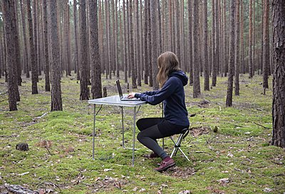 Woman with laptop in the forest - p1229m2291876 by noa-mar