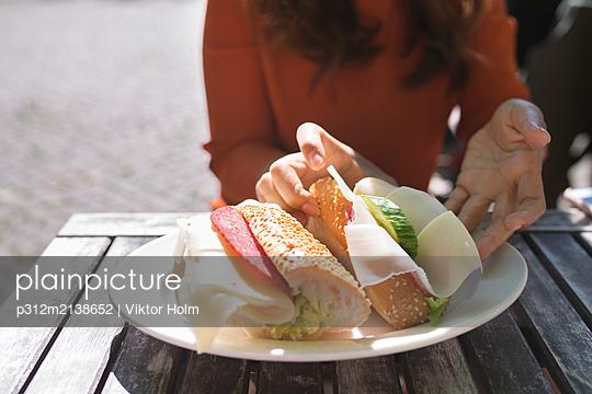 Woman having sandwich - p312m2138652 by Viktor Holm