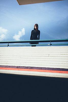 Woman on a bridge - p1076m926051 by TOBSN