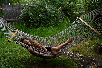 Girl in Hammock - p523m1169868 by Lisa Kimmell
