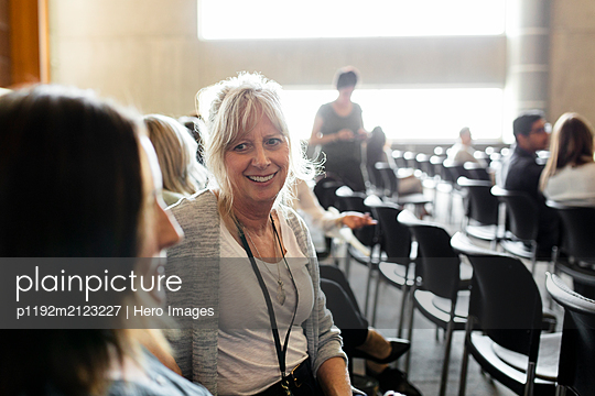 Businesswomen talking in conference audience - p1192m2123227 by Hero Images