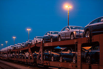 Car-carrying train at night - p229m1424608 by Martin Langer