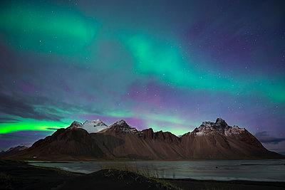 Iceland, Hoefn, Northern lights over Vesturhorn Mountains - p300m1120914f by Maria Elena Pueyo Ruiz