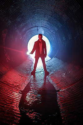 Detective in Tunnel with Water - p1019m1477052 by Stephen Carroll