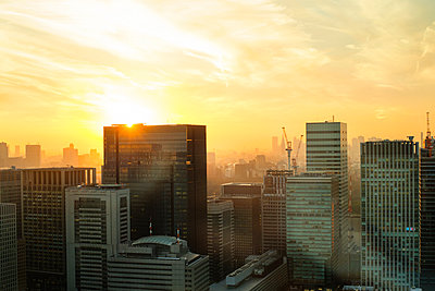 View of city buildings against sky during sunset - p1166m1150485 by Cavan Images