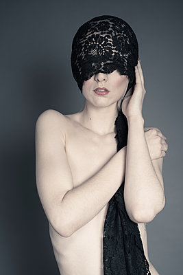 Non-explicit nude head to mid-section covering herself with her arm, with a lace scarf over her head and obscuring her face. - p1433m1511159 by Wolf Kettler