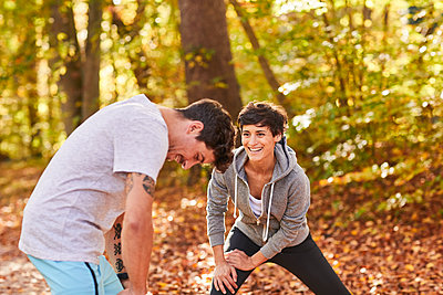 Couple stretching in autumn forest - p300m1581494 by Stefan Hobmaier