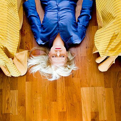 Woman lying on the floor - p4130047 by Tuomas Marttila