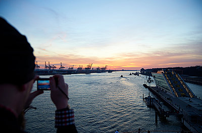 Harbor at sunset - p851m1048593 by Lohfink
