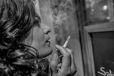 Smoking woman - p1508m2022380 by Mona Alikhah