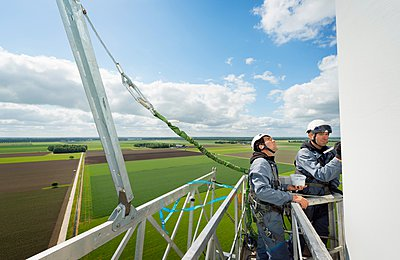 Maintenance work on the blades of a wind turbine - p429m1047138 by Mischa Keijser