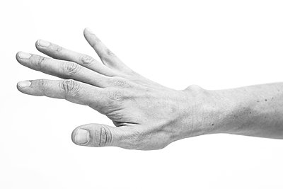 Close-up of Mid-Adult Woman's Hand and Forearm - p694m2097247 by Lori Adams