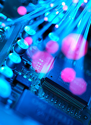 Fibre optics carrying data passing across electronic circuit board - p300m2131649 by Andrew Brookes