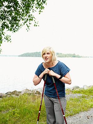 Woman with walking poles Sweden. - p31220327f by Fredrik Nyman