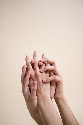Hands touching each other - p427m1541641 by Ralf Mohr