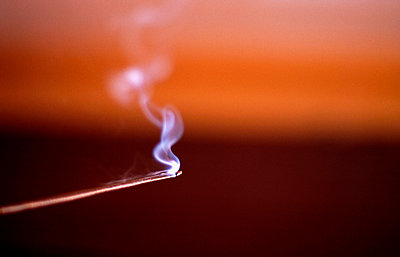 A burning Nag Champa joss stick - p8850030 by Oliver Brenneisen