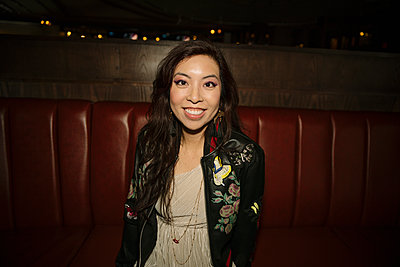 Portrait smiling, confident female millennial in nightclub - p1192m1583658 by Hero Images