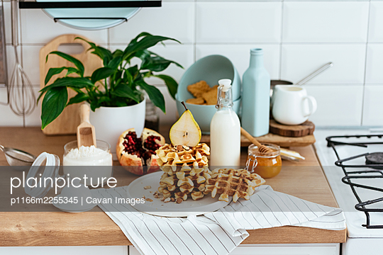 homemade waffles. ingredients. kitchen. morning. - p1166m2255345 by Cavan Images