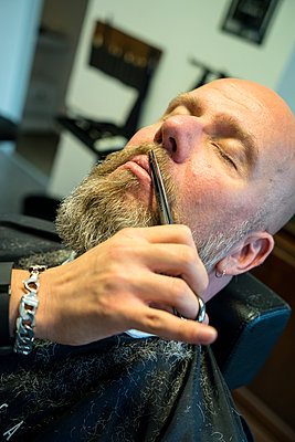 At the barber's - p427m1286522 by Ralf Mohr