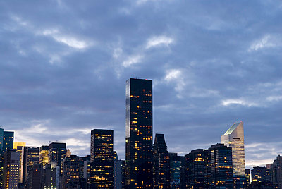 Midtown Manhattan Skyline at Dusk and Cloudy Sky, New York City - p5690117 by Jeff Spielman