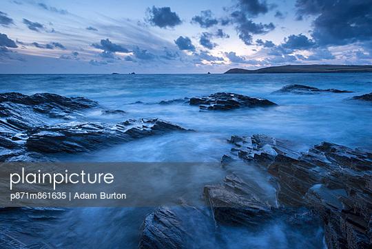Twilight over Trevose Head from the rocky shores of Treyarnon Point - p871m861635 by Adam Burton