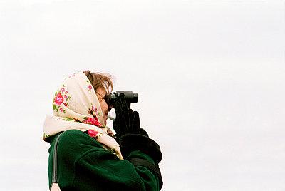 Woman with binoculars - p3880171 by Jim Green