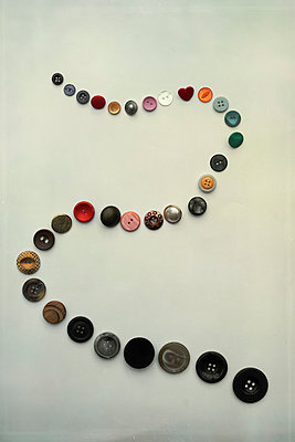 Curved line of buttons - p1228m1488435 by Benjamin Harte