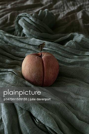 Peach on cloth - p1470m1539155 by julie davenport